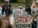 Ronald Reagan Riding Horse Near Man Holding Up Sign Emblazoned with Stop Reagan