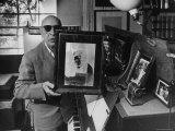 Igor Stravinsky Holding a Negative Image Portrait of Mozart