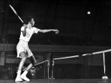 Tennis Player Althea Gibson  Preparing to Hit the Ball While Playing Tennis