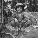 Filipino Boy Travelling with American Soldiers of 33rd Inf Div During Fight to Regain Philippines