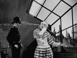Charlie Chaplin Squirting Water Into Face of Policeman  Scene from Limelight