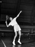 Tennis Player Althea Gibson  Serving the Ball While Playing Tennis