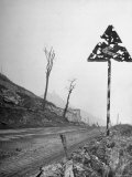 Road Sign Perforated by Shell Fragments Gives Mute Testimony to the Bitter Struggle
