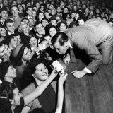 Comedian Milton Berle Trying to Kiss Fans Who Are Asking for Autographs