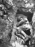 American Soldier of Mechanized Unit Sleeping in Foxhole Lined with Cardboard