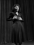 Edith Piaf with Hands on Breast and Midriff