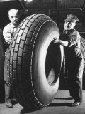 Workers with Truck Tires at Us Rubber Plant