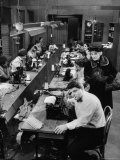 Playwright Paddy Chayefsky Sitting at Typewriter in Garment Factory With Workers on Sewing Machines