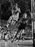 Burke Scott of Hoosiers Basketball Team Leaping Through Air Towards Lay Up Shot at Basketball Hoop