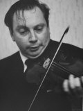 Violinist Isaac Stern Playing at a Party