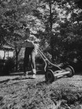 American Boy Mows Lawns to Earn Extra Money During Summer Months  He Gets Jobs Thru Newspaper Ads