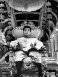 "King Norodom Sihanouk of Cambodia Sitting in His Throne Wearing ""Sampots""  Sarong Style Pants"