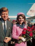 President John F Kennedy Standing with Wife Jackie After Their Arrival at the Airport