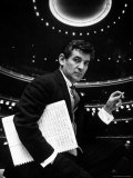 36 Year Old Composer Leonard Bernstein  Holding Musical Score with Lighted Auditorium Behind Him