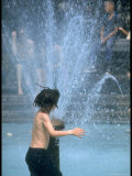 Children Cooling Off in the Spray of a Firehydrant on New York City Street
