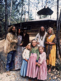 Family of Mystic Arts Commune Members in Front of Home They've Lived in for over One Year