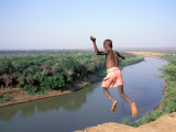 Karo Boy Leaps Off a Cliff Over the Omo River  Ethiopia