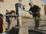 An Elderly Man Pumps Water from a Public Well in Kabul  Afghanistan  Friday  September 22  2006