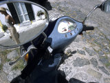Reflection of Young Woman in Mirror of Vespa Bike  Italy