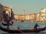 Gondoliers with Passengers in Venetian Canals  Venice  Italy