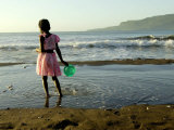 A Girl Walks on the Beach in Jacmel  Haiti  in This February 5  2001