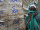 A Somali Child Covers Her Face at Dadaab Refugee Camp in Northern Kenya Monday  August 7 2006