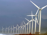 Villagers are Dwarfed by Giant Windmills Built by the Danish Development Agency