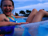 Young Girl Floating in Swimming Pool in Rubber Ring  Gold Coast  Australia