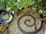 Pebble Patio with Swirl Design Small Mosaic Raised Pond  Plants in Pots  Brighton