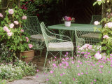 Green Metal Table & Chairs Beneath Arbour