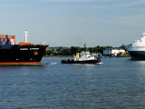 Tug Guiding a Containership Along the River Thames Near Tilbury  England