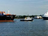 Tug Guiding a Containership Along the River Thames Near Tilbury  England