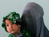 An Afghan Mother Waits with Her Daughter Before Attending Medical Care