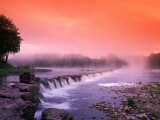 Sunrise in the morning mist over the waterfall on the Venta River near Kuldiga  Latvia