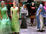Two Afghan Woman Walk Next to Mannequins at a Women's Gallery Downtown Kabul