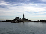 Boston Light is Seen on Little Brewster Island in Boston Harbor