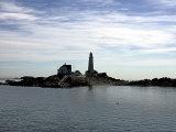 Boston Light is Seen on Little Brewster Island in Boston Harbor