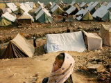 A Kashmiri Boy Left Homeless by October's Earthquake Looks Over a Refugee Camp