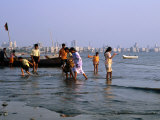 Locals Cooling off in Polluted Waters at Chowpatty Beach  Mumbai  India