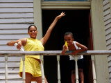 Young Girl and Boy on Balcony  Galveston  USA