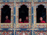 Buddhist Monks Look Through the Windows into the Courtyard of the Tango Monestary Near Thimphu