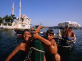 Kids with Ortakoy Mosque in Background  Istanbul  Turkey