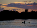 Boaters on Amazon River at Sunset  Amazon River Basin  Peru