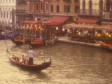 Gondoliers on the Grand Canal  Venice  Italy