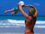 Mother Swinging Baby on Varadero Beach  Varadero  Cuba