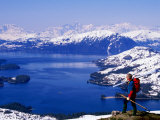 Hiker Overlooking Lake with Mountains in Distance  Prince William Sound  USA
