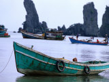 Fishing Boats in Front of the &quot;Father and Son&quot; Rock Formations at Duong Beach Near Ha Tien  Vietnam