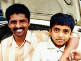 Portrait of Father and Son on Car at Devaraja Market  Mysore  India