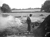 A Farmer Holding a Shovel on a Farm in England  1938