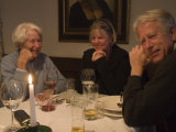 A Family Sits Around the Dinner Table at a Restaurant  Fraueninsel  Chiemsee  Bavaria  Germany